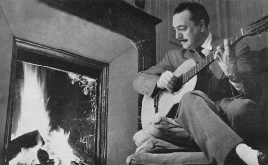 295-Django-playing-his-classical-guitar-1-553x340